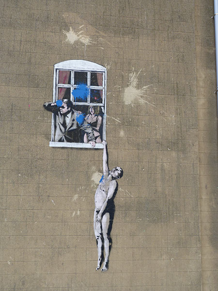 Banksy Naked Man Hanging From Window