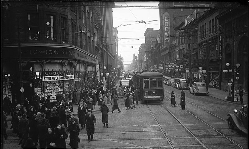 Traffic on Yonge Street looking north from south side of Queen Street. Friday December 20th 1935